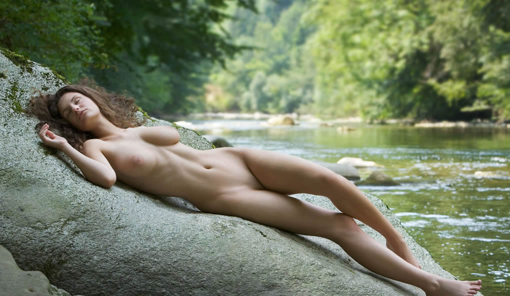 Busty nudist posing naked rocks share